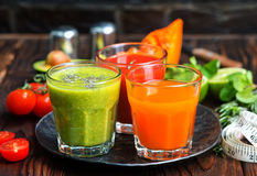 Smoothies. In glass and on a table royalty free stock image