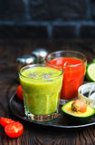 Smoothies. In glass and on a table royalty free stock photo