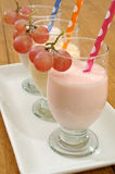 Smoothies with grape Stock Images