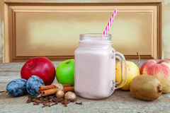Smoothies, healthy eating. Smoothies, yogurt with fruit on old wooden surface, Healthy Eating royalty free stock images