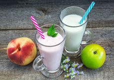 Smoothies, healthy eating. Smoothies, yogurt with fruit on old wooden surface, Healthy Eating royalty free stock photo