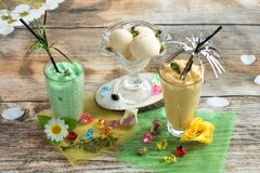 Smoothies and ice cream. Healthy summer. Breakfast on the veranda Royalty Free Stock Photography