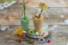 Smoothies and ice cream. Healthy summer. Breakfast on the veranda Royalty Free Stock Photos
