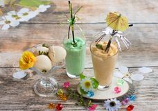 Smoothies and ice cream. Healthy summer. Breakfast on the veranda Stock Images
