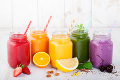 Smoothies, juices, beverages, drinks variety with fresh fruits and berries Royalty Free Stock Images