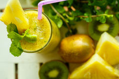 Smoothies of kiwi and pineapple on the table. Top view Royalty Free Stock Photography