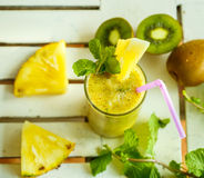 Smoothies of kiwi and pineapple on the table. Top view Stock Photos