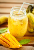 Smoothies mango and banana in a glass jar Stock Image