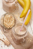 Smoothies with milk, oatmeal and flax seeds Royalty Free Stock Image