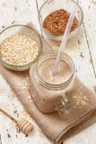 Smoothies with milk, oatmeal and flax seeds Stock Images