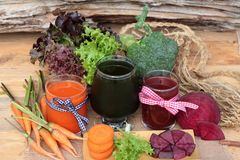 Smoothies mixed vegetables, beetroot, carrot and green vegetable Royalty Free Stock Photography