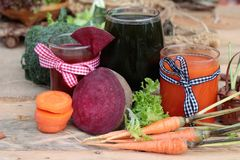 Smoothies mixed vegetables, beetroot, carrot and green vegetable Royalty Free Stock Photo