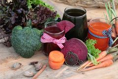 Smoothies mixed vegetables, beetroot, carrot and green vegetable Royalty Free Stock Images