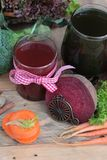 Smoothies mixed vegetables, beetroot, carrot and green vegetable Stock Photos