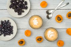 Smoothies of mulberries, apricot and mint Stock Images