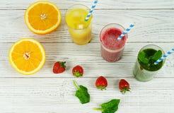 Smoothies och orange fruktsaft Royaltyfri Foto