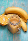 Smoothies orange banana in a mason jar Stock Photo
