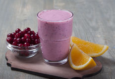 Smoothies and orange and cranberries . Stock Photos