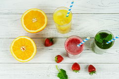 Smoothies and orange juice. In assortment on a white background Royalty Free Stock Image