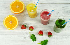 Smoothies and orange juice. In assortment on a white background Royalty Free Stock Photo