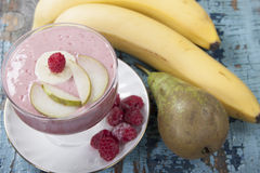 Smoothies of pear, banana and frozen raspberries with yogurt. Royalty Free Stock Image