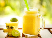 Smoothies pineapple with lime in jar Royalty Free Stock Photo