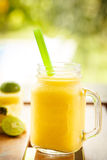 Smoothies pineapple with lime in jar Royalty Free Stock Images