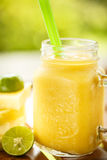 Smoothies pineapple with lime in jar Stock Images