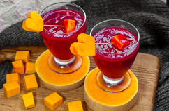 Smoothies of raspberry, with a mouth-watering pumpkin in the form  hearts Stock Image