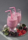 Smoothies of strawberry and shadberry Stock Photos