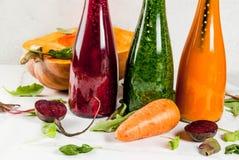 Smoothies végétaux colorés Photo stock