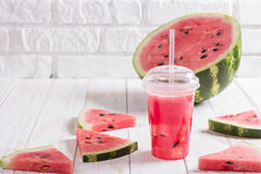 Smoothies Of Watermelon Juice In A Plastic Cup With A Straw. Fre Royalty Free Stock Photo