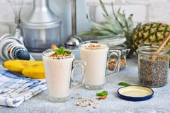 Smoothies with yoghurt, pineapple and banana for breakfast. A natural diet drink. Detox menu royalty free stock photos