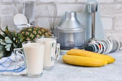 Smoothies with yoghurt, pineapple and banana for breakfast. A natural diet drink. Detox menu stock photography