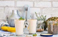 Smoothies with yoghurt, pineapple and banana for breakfast. A natural diet drink. Detox menu royalty free stock photo