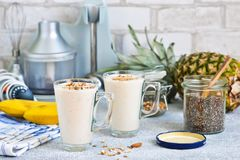 Smoothies with yoghurt, pineapple and banana for breakfast. A natural diet drink. Detox menu stock photo