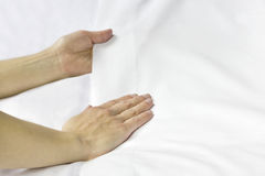 Smoothing a bed sheet. Stock Images
