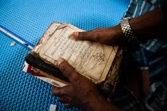 Smoothing the holy book. Rohingya refugees was smoothing the holy book after reading it to calming their hearts longing for home and the uncertainty over the stock photo