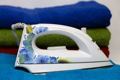 Smoothing-iron with a pattern of blue flowers Stock Photo