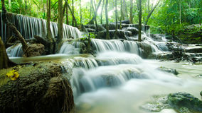 Smoothly water fall. Multi level water fall with rock in the forest Stock Image