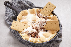 Smores dip baked in a cast iron pan Royalty Free Stock Photo