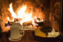Smores treats in front of a fireplace Royalty Free Stock Photography