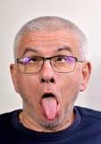 Smorfia dell'uomo anziano Fotografie Stock Libere da Diritti