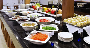 Smorgasbord - food choice in a restaurant. Vegetables royalty free stock photography