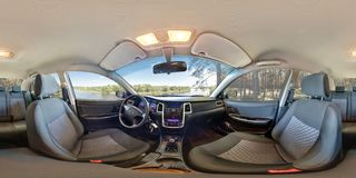 SMORGON, BELARUS - MAY 3, 2014: Full 360 equirectangular spherical panorama in the interior of prestige modern car geely emgrand. Cs7 in summer forest stock image