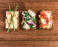 Smorrebrod - danish open sandwich with fish, herring, cheese Royalty Free Stock Images