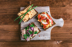 Smorrebrod - danish open sandwich with fish, herring, cheese Royalty Free Stock Photography