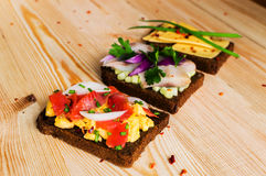 Smorrebrod - danish open sandwich with fish, herring, cheese Royalty Free Stock Image