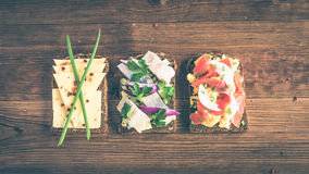 Smorrebrod - danish open sandwich with fish, herring, cheese Stock Photography