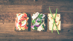 Smorrebrod - danish open sandwich with fish, herring, cheese Stock Images